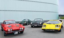 Bilder Classic Cars Vergleich Aston Martin DB6 Corvette Sting Ray Lamborghini Countach Porsche 911