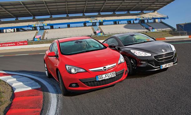Bilder Opel Astra GTC Peugeot RCZ Markenvergleich