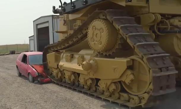 Caterpillar D11 vs. Pontiac Firefly: Video